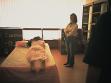 Violeta Çarku, Waiting For A Curator Kiss (Čekání na polibek kurátora), performance v knihkupectví Národní galerie v Tiraně, foto: Alexis  Zoliakoff