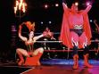 Miss Satanica presents Lucifer to  the crowd. Photos Bob Debris 2003 Los Angeles CA.