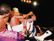Rudo misterioso tries to help partner Gringo Loco as he is being decimated by Hijo de Santo.