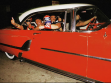 Luchadores crusin the streets of L.A.. Pilota Suicida and Chilango give the thumbs up.