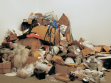 David Ellis Heap, 2008, collected trash from Brooklyn and Manhattan, QRS midi interface, dimensions variable. Installation view The Dozens, Roebling Hall, New York, 2008, Photo: Jimmy Fonatine, courtesy Roebling Hall.