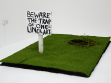 Beth Fox 'One-Liner Art'  2012, wooden sign, turf, branches, charcoal dimensions variable